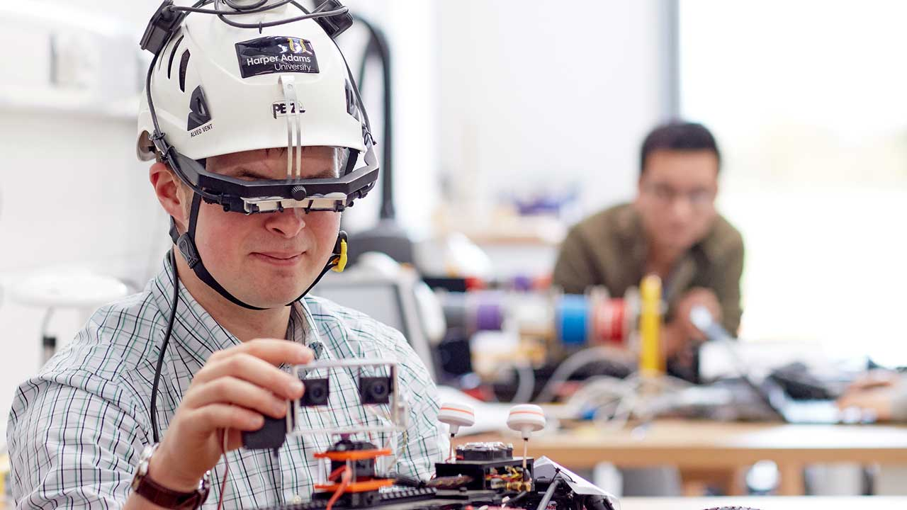 Image description: Student working on an engineering project.